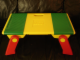 Gear No: 6787c01  Name: Playtable with Red Folding Legs with Compartment Covers