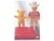 Gear No: lap02-027  Name: Postcard - Lego Art Project 2002 - 027 - Minifigure with Yellow Bear Behind Red Brick