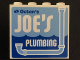Part No: 60581pb046  Name: Panel 1 x 4 x 3 with Side Supports - Hollow Studs with 'Octan's JOE'S PLUMBING' and Light Blue Drain Pipe Pattern (Sticker) - Set 70811