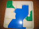 Part No: 6447px1  Name: Duplo, Baseplate Raised 24 x 24 with Straight Ramp and Blue, Green Pattern