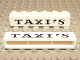 Part No: crssprt02pb09  Name: Brick 1 x 6 without Bottom Tubes with Cross Side Supports with Black 'TAXI'S' Serif Thin Pattern