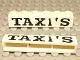 Part No: crssprt02pb14  Name: Brick 1 x 6 without Bottom Tubes with Cross Side Supports with Black 'TAXI'S' Serif Bold Large Pattern