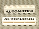 Part No: crssprt02pb20  Name: Brick 1 x 6 without Bottom Tubes with Cross Side Supports with Black 'AUTOMATIEK' Pattern