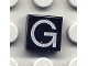 Part No: 3070bpb015  Name: Tile 1 x 1 with Groove with Letter Capital G Pattern