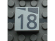 Part No: Mx1022Apb174  Name: Modulex Tile 2 x 2 with Dark Gray Slopes and Calendar Week Number '18' Pattern