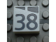Part No: Mx1022Apb194  Name: Modulex Tile 2 x 2 with Dark Gray Slopes and Calendar Week Number '38' Pattern