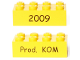 Part No: 3001pb115  Name: Brick 2 x 4 with Black '2009' Front and 'Prod. KOM' Back Kornmarken Factory Tour Pattern