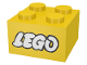 Part No: 3003pb008  Name: Brick 2 x 2 with Lego Logo Old Style White with Black Outline Pattern