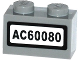 Part No: 3004pb135  Name: Brick 1 x 2 with 'AC60080' Pattern (Sticker) - Set 60080