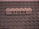 Part No: 3009px55  Name: Brick 1 x 6 with Black 'STORE' Pattern