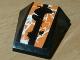 Part No: 47753pb078  Name: Wedge 4 x 4 No Top Studs with Black, Orange and White Splatter Pattern (Sticker) - Set 42007
