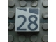 Part No: Mx1022Apb184  Name: Modulex Tile 2 x 2 with Dark Gray Slopes and Calendar Week Number '28' Pattern