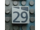Part No: Mx1022Apb185  Name: Modulex Tile 2 x 2 with Dark Gray Slopes and Calendar Week Number '29' Pattern