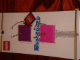 Gear No: 4507877  Name: 2 x 2 Brick - Soft Key Cover Key Chain Set - Purple and Dark Pink