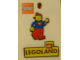Gear No: 712199  Name: Pin, Minifigure - Girl with Blue Top, Red Legs, Brown Ponytail Hair, and Pin, Legoland - Set of 2