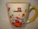 Gear No: LLFMug02  Name: Food - Cup / Mug, Legoland Florida Grand Opening 2011 Yellow Handle Pattern