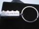 Gear No: bb0251  Name: 2 x 4 Brick - Chrome Silver Key Chain embossed with 'LEGO Toy of the Century'