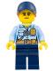 Minifig No: cty0992  Name: Police - City Officer Female, Bright Light Blue Shirt with Badge and Radio, Dark Blue Legs, Dark Blue Cap with Dark Orange Ponytail