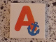 Part No: 3068bpb0710  Name: Tile 2 x 2 with Groove with Letter A Red with Anchor Pattern