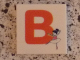 Part No: 3068bpb0711  Name: Tile 2 x 2 with Groove with Letter B Red with Ballerina Pattern