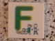 Part No: 3068bpb0715  Name: Tile 2 x 2 with Groove with Letter F Green with Family Pattern