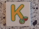 Part No: 3068bpb0720  Name: Tile 2 x 2 with Groove with Letter K Yellow with Kiwi Pattern