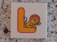 Part No: 3068bpb0721  Name: Tile 2 x 2 with Groove with Letter L Yellow with Lion Pattern