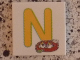 Part No: 3068bpb0723  Name: Tile 2 x 2 with Groove with Letter N Yellow with Nest Pattern