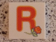 Part No: 3068bpb0727  Name: Tile 2 x 2 with Groove with Letter R Red with Rose Pattern