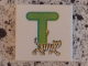 Part No: 3068bpb0729  Name: Tile 2 x 2 with Groove with Letter T Lime with Tiger Pattern