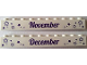 Part No: 6111pb020  Name: Brick 1 x 10 with Dark Purple 'November' and 'December' Pattern on Opposite Sides