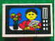Part No: BA052pb03  Name: Stickered Assembly 6 x 2 x 3 1/3 with Flowers and Figure on TV Screen Pattern (Sticker) - Set 268-1 - 3 Bricks 2 x 4, 3 Bricks 2 x 2, 3 Tiles 2 x 2