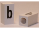Part No: bb0695pb46  Name: Tile, Modified 1 x 2 x 5/6 with Stud Hole in End and Black 'b' Lower Case Pattern