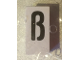 "Part No: bb0695pb71  Name: Tile, Modified 1 x 2 x 5/6 with Stud Hole in End and Black ""ß"" Pattern (sharp S)"