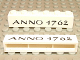 Part No: crssprt02pb08  Name: Brick 1 x 6 without Bottom Tubes with Cross Side Supports with Black 'ANNO 1762' Pattern