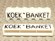 Part No: crssprt02pb11  Name: Brick 1 x 6 without Bottom Tubes with Cross Side Supports with Black 'KOEK ' BANKET' Pattern