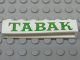 Part No: crssprt02pb56  Name: Brick 1 x 6 without Bottom Tubes with Cross Side Supports with Green 'TABAK' Serif Pattern