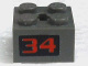 Part No: 40902pb01  Name: Hinge Brick 2 x 2 Locking with 2 Fingers Vertical and Axle Hole with Red '34' on Black Background Pattern (Sticker) - Set 4589