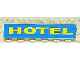 Part No: 3067pb10  Name: Brick 1 x 6 without Bottom Tubes with Yellow on Blue 'HOTEL' Pattern