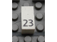 Part No: Mx1021Apb42  Name: Modulex Tile 1 x 2 with Black Calendar Day Number '23' Pattern