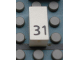 Part No: Mx1021Apb50  Name: Modulex Tile 1 x 2 with Black Calendar Day Number '31' Pattern
