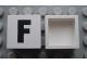 Part No: Mx1022Apb070  Name: Modulex Tile 2 x 2 with Black 'F' Pattern (no internal support)