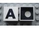Part No: Mx1022Cpb01  Name: Modulex Tile 2 x 2 with Black 'A' Pattern (Black internal lining with White dot)