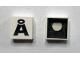 Part No: Mx1022Cpb43  Name: Modulex Tile 2 x 2 with Black 'Å' Pattern (Black internal lining with White dot)