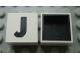 Part No: Mx1022Dpb10  Name: Modulex Tile 2 x 2 with Black 'J' Pattern (Black internal lining no dot)