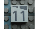 Part No: Mx1022Apb167  Name: Modulex Tile 2 x 2 with Dark Gray Slopes and Calendar Week Number '11' Pattern