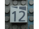 Part No: Mx1022Apb168  Name: Modulex Tile 2 x 2 with Dark Gray Slopes and Calendar Week Number '12' Pattern