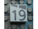 Part No: Mx1022Apb175  Name: Modulex, Tile 2 x 2 with Dark Gray Slopes and Calendar Week Number '19' Pattern