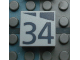 Part No: Mx1022Apb190  Name: Modulex, Tile 2 x 2 with Dark Gray Slopes and Calendar Week Number '34' Pattern