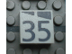 Part No: Mx1022Apb191  Name: Modulex, Tile 2 x 2 with Dark Gray Slopes and Calendar Week Number '35' Pattern